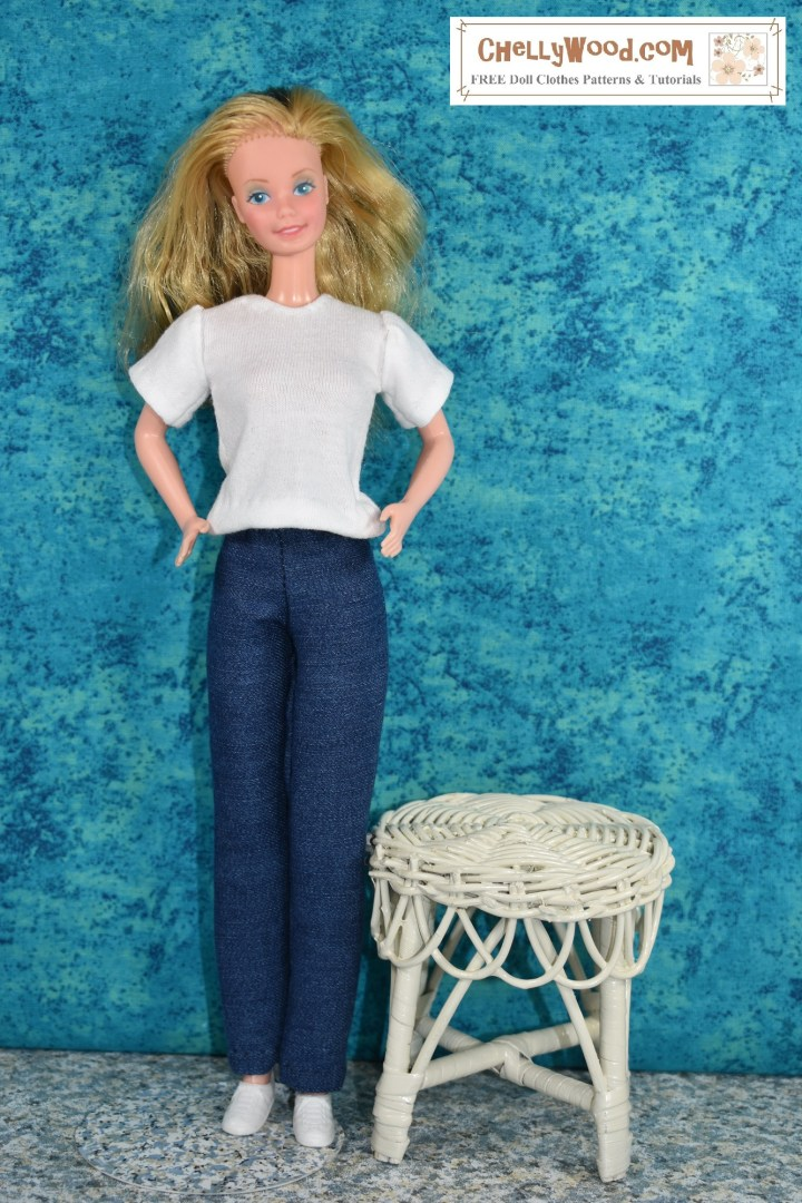 The photo shows a SuperStar Barbie in front of a turquoise-colored canvas. She wears a pair of handmade jeans and a handmade T-shirt. She stands beside a wicker table. Would you like to make these doll clothes for your vintage Barbie? The free printable PDF sewing patterns for these and other vintage Barbie doll clothes can be found at ChellyWood.com, along with hundreds of additional patterns to fit dolls of many shapes and all different sizes.
