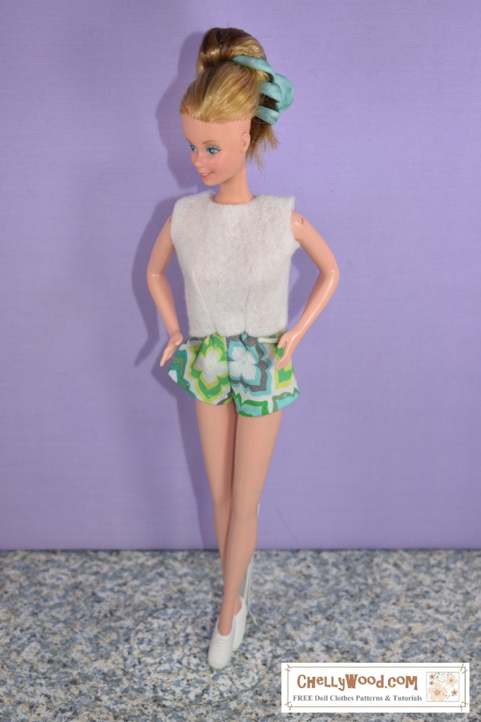 """Please click on the link in the caption to navigate to the page where you can download free printable sewing patterns for making this outfit. This image shows a SuperStar Barbie from the early 1980's modeling a pair of short-shorts in geometric-design-patterned fabric and a felt sleeveless """"sweater,"""" both of which were handmade using Chelly Wood's free printable sewing patterns. If you'd like to learn more about Chelly Wood's free PDF sewing patterns, visit ChellyWood.com"""