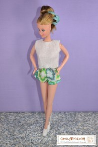 "Please click on the link in the caption to navigate to the page where you can download free printable sewing patterns for making this outfit. This image shows a SuperStar Barbie from the early 1980's modeling a pair of short-shorts in geometric-design-patterned fabric and a felt sleeveless ""sweater,"" both of which were handmade using Chelly Wood's free printable sewing patterns. If you'd like to learn more about Chelly Wood's free PDF sewing patterns, visit ChellyWood.com"