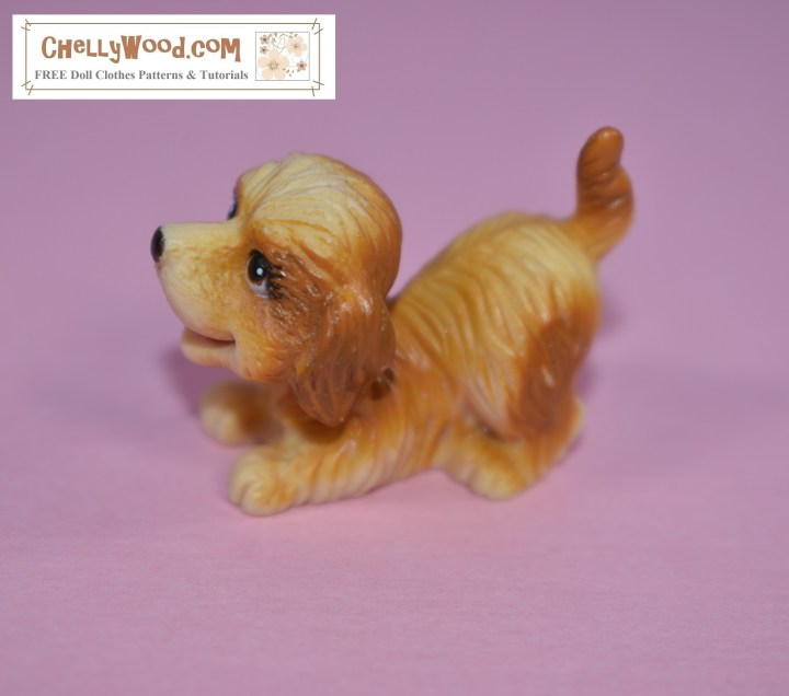 "This tiny plastic dog is the smallest of the bunch. He looks like a cocker spaniel jumping into his ""let's play"" pose with his hind quarters high in the air, tail wagging, and his front paws splayed out in front of him."