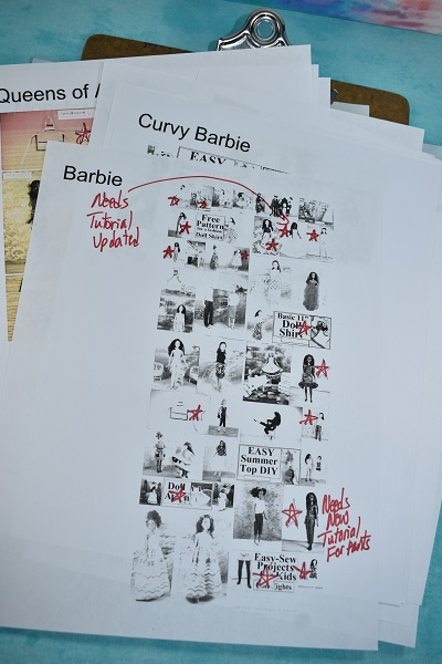 "Image shows a stack of papers with doll photos in a gallery. Red Sharpie marker has been written over the top of the images with notes that say things like ""Needs tutorial updated"" and random thoughts like that."