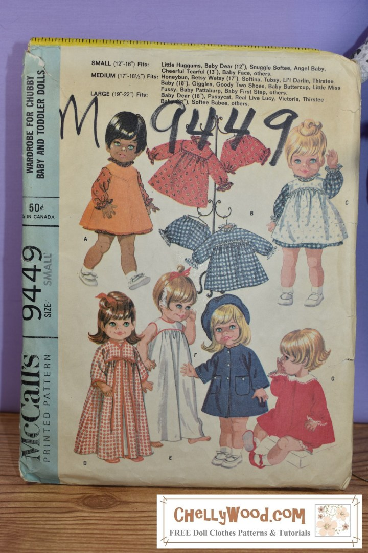 """The image shows a vintage McCall's printed sewing pattern for making a wardrobe of doll clothes for """"chubby baby and toddler dolls"""" in the size range from 12 to 22 inches, depending upon whether you purchase the small, medium, or large doll clothes pattern set. The striking image on this pattern (published by McCall's in 1968) is the fact that a doll with brown skin and black hair appears on this pattern front, along with a variety of little blond and red headed dolls."""