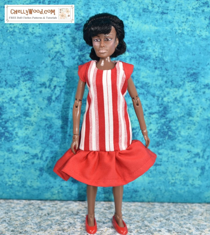 The image shows a Lieutenant Uhura doll (in the likeness of actress Nichelle Nichols) wearing a handmade dress with a dropped ruffle and cap sleeves. The main part of the dress is made of red and white striped cotton fabric that looks a lot like the stripes on a peppermint candy. The watermark reminds you to go to ChellyWood.com for free printable sewing patterns for making doll clothes to fit dolls and action figures of many shapes and all different sizes.