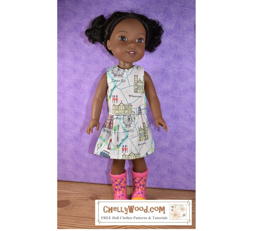 "The image shows a 14 and a half inch Wellie Wishers doll from American Girl doll company modeling a handmade doll skirt and matching shirt. The fabric used is a ""London-themed"" printed fabric made of 100% cotton. This fabric was purchased at Hobby Lobby. If you'd like to make your own version of this outfit (a shirt and matching skirt), go to ChellyWood.com for the free printable PDF sewing patterns and the free tutorial videos showing how to make each item of doll clothes modeled here."
