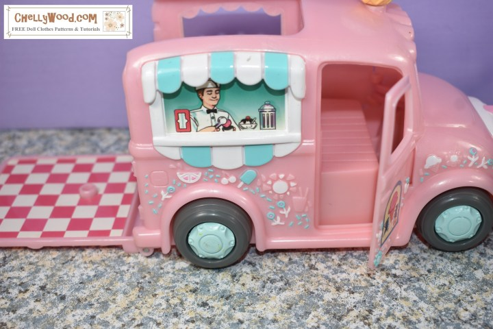 This image shows that the passenger side of the Polly Pocket ice cream truck also has a door that swings open to reveal a realistic seat. Also, the back of the delivery truck lays flat against the pavement to expose a pink and white checkered floor that likely once held a table for customers to eat at.