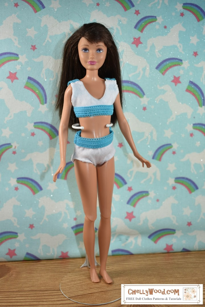 Would you like to make this set of underwear or bikini style swimsuit for your 10 inch doll? Click on the link in the caption. This image shows a Mattel Skipper doll wearing a handmade pair of underpants and a sports bra (could also be a bikini style swimsuit). This set of doll clothes was handmade using Chelly Wood's free printable PDF sewing patterns and following directions found in her tutorial videos. The free patterns and the tutorials are found on the page where the link leads to. Please click on the link in the caption to make this adorable sports bra and panties (or swimwear) to fit your Skipper doll (little sister of Barbie) or a similar sized doll.