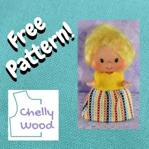"""This image shows a Lemon Meringue doll from the vintage Strawberry Shortcake collection wearing a handmade dress. The photo of the doll is overlaid on a turquoise cloth background with the words """"free pattern"""" boldly expressed in the side margin. The bodice of the dress is bright yellow, like Lemon Meringue's curly yellow hair. It's a felt bodice, so it has a certain fluffy texture to it. The lower half of the dress--the skirt part--is made of multicolored cotton fabric. This fabric is decorated with little lines formed by aligned letter exes, in the colors blue, yellow, red, green, orange, and black on a white cotton background color. The doll stands with chubby cheeks and sparkling eyes, looking straight at the camera in anticipation. The watermark reminds us to visit ChellyWood.com for a free printable PDF sewing pattern to make this and other doll clothes to fit dolls of many shapes and sizes."""