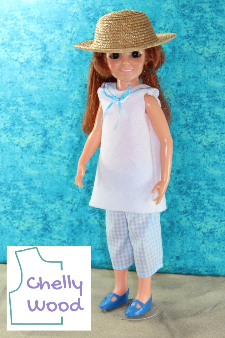 This photo shows a classic Crissy doll wearing a sailor-style suit and straw hat. If you'd like to make this sailor suit for your Crissy doll (or a doll of a similar size and shape), please click on the link in the caption.