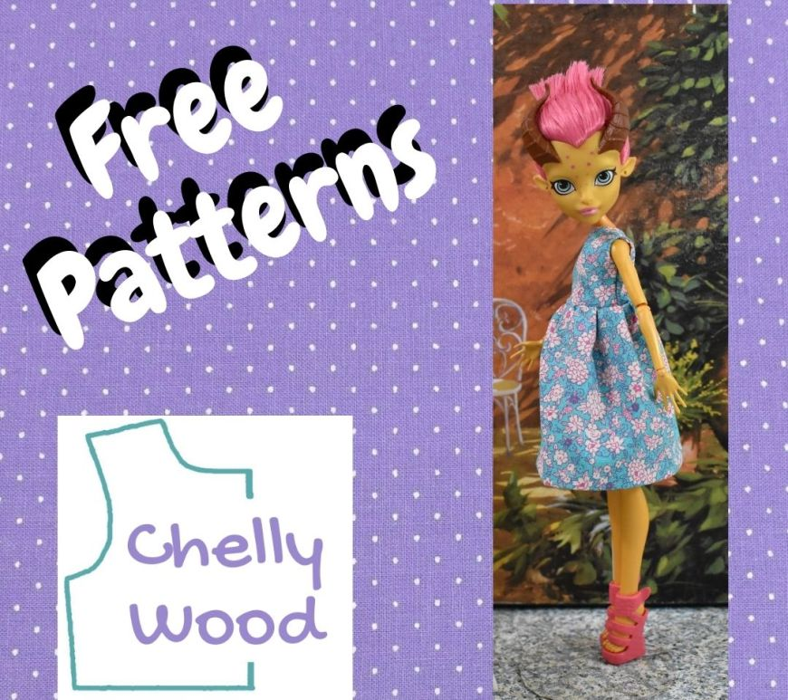 """In a purple polka dot frame, we see the words """"free patterns"""" along with the Chelly Wood website logo and a photograph of Monster High doll Gilda Goldstag staring at the camera. The doll wears a tiny blue dress decorated in white flowers that are outlined in soft pink. If you'd like to make this dress, you can find the free printable PDF sewing pattern for this and other monster high doll clothes at ChellyWood.com"""
