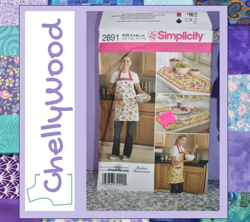 An apron is a simple Christmas gift to make. You can usually whip one up in a couple of hours. On ChellyWood.com, the doll clothing designer, Chelly Wood, offers advice for making aprons for the whole family for Christmas. This image shows a quilted background with the photo of Simplicity Apron pattern 2691, showing an apron with a pocket and contrasting colors of fabric, along with a quilt-look table runner and a placemat pattern. Visit ChellyWood.com to join the chat.