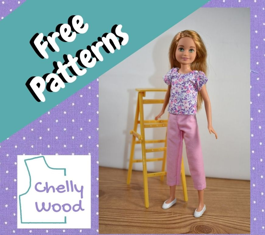 """This is a square image of a purple frame with turquoise blue swatch overlaid. The words in the turquoise blue swatch of linen fabric say """"free patterns"""" and in the corner of the image, we see the Chelly Wood logo. There's a photo, front and almost center"""" of a Mattel 9 inch Stacie doll modeling handmade doll clothes. She wears a floral print white pink and purple short-sleeved shirt and pink capri pants. She also wears white plastic flat shoes which sharply contrast the wooden floor of the room she's in. The room has a white wall, which Stacie looks like she's getting ready to paint because there's a paint ladder near her (and slightly behind her)."""