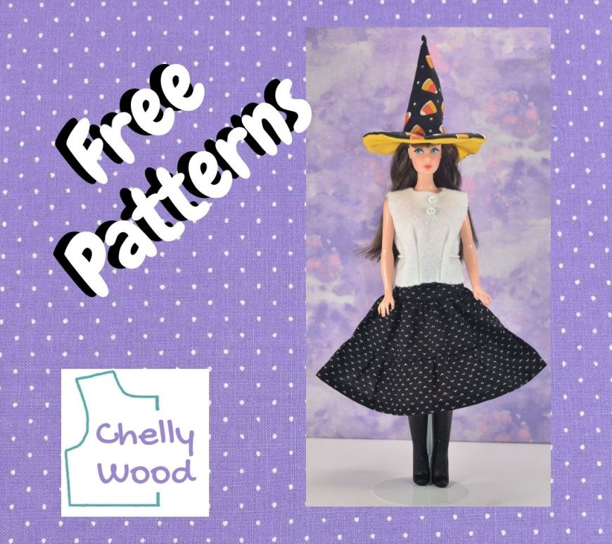 """The image shows a brunette vintage (or vintage reproduction) Barbie wearing a black 3-tier skirt that flares out, a white felt sleeveless shirt that tapers at the waist, and a tall black witch's hat. This photo is framed by a purple fabric frame with tiny white polka dots and the words """"free patterns."""" In the lower left corner, we also see the Chelly Wood dot com logo."""