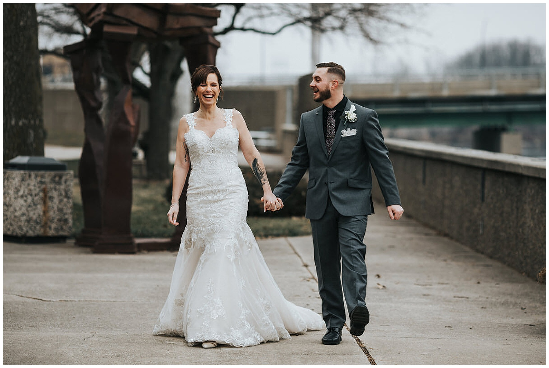 Bride and Groom walk hand in hand at the Waterloo Center for the Arts