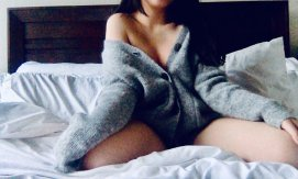 Photo of Asian escort Chelsea wearing an oversized sweater