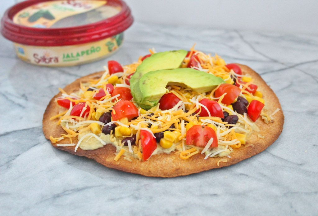 My vegetarian Mexican pizza is the perfect throw together appetizer, lunch, or dinner. Made with just 7 simple ingredients, this zesty twist on the Italian classic will be a new family favorite.