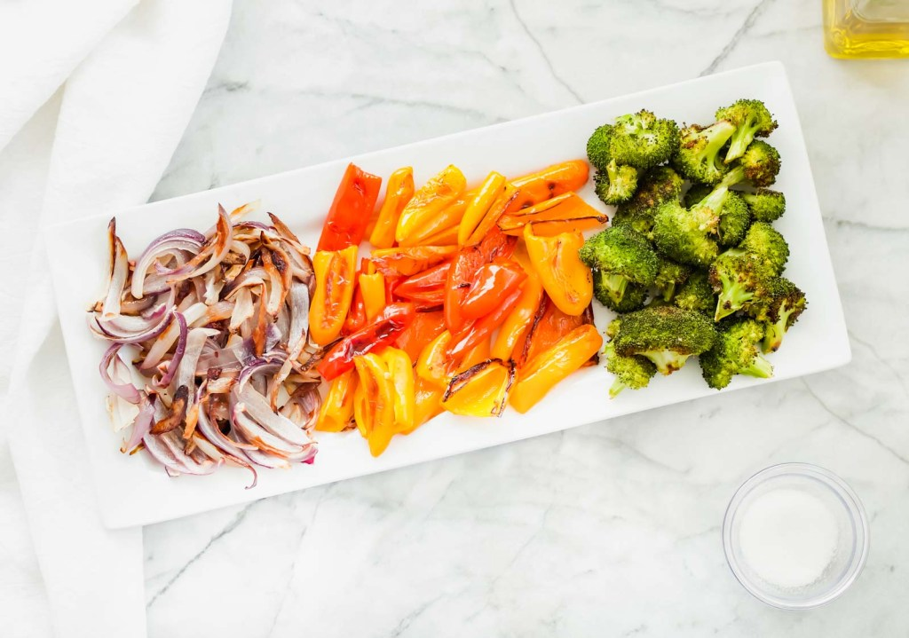 This healthy oven roasted mini sweet peppers with broccoli and red onion recipe will now be your go to weekly meal prep recipe. Use these veggies in Mexican, Indian, or Asian inspired dishes.