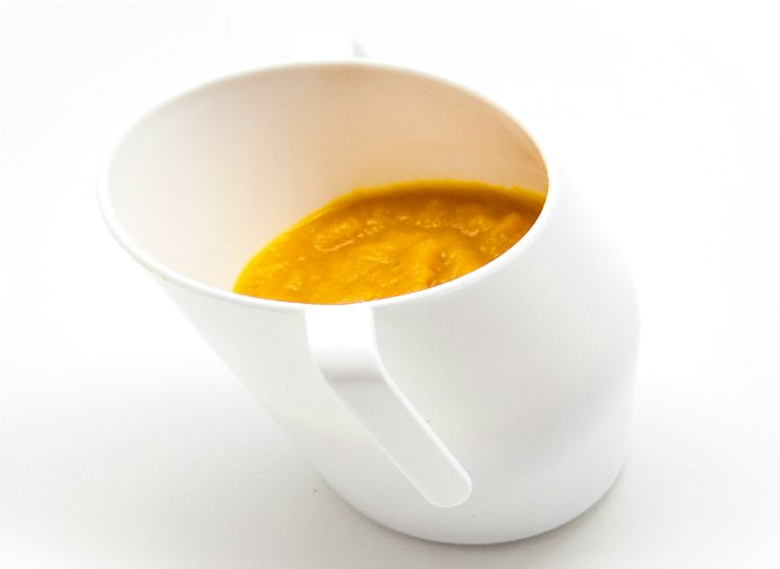 orange soup in cup