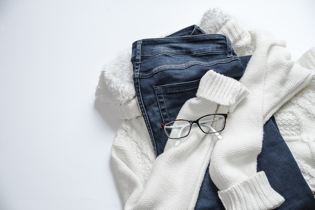 black-framed-eyeglasses-on-white-jacket-and-blue-denim
