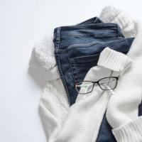 black-framed-eyeglasses-on-white-jacket-and-blue-denim