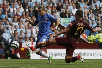 Fernando+Torres+shoots+past+Manchester+City's+Aleksandar+Kolarov+to+score+his+side's+first+goal+during+their+Community+Shield+soccer+match+at+Villa+Park