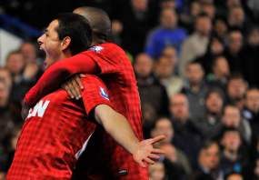 Manchester United's Hernadez celebrates scoring with Young during their English Premier League soccer match in London