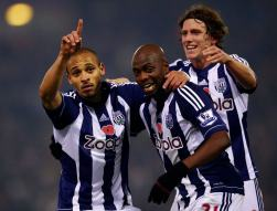 West Bromwich Albion's Odemwingie celebrates goal against Southampton with Mulumbu and Jones during English Premier League soccer match in West Bromwich