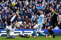 Manchester City's Aguero shoots past Chelsea's Cech during their English Premier League soccer match in Manchester