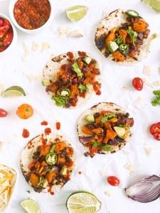 Butternut Squash Black Bean Tacos in soft taco shells, laying flat