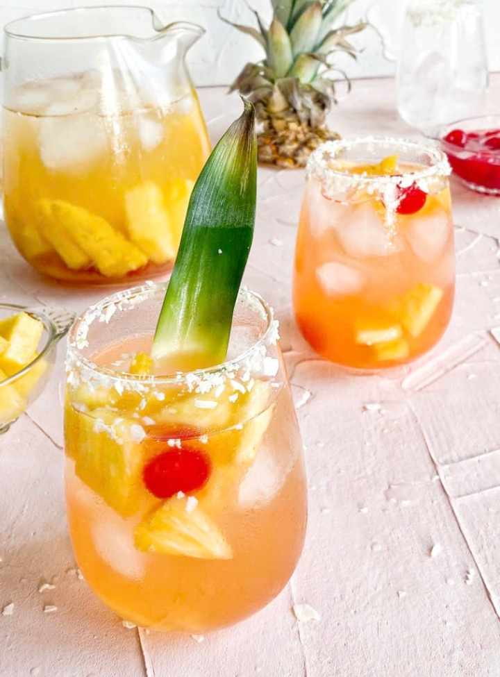 Pina Colada Sangria in coconut rum glasses and a pitcher