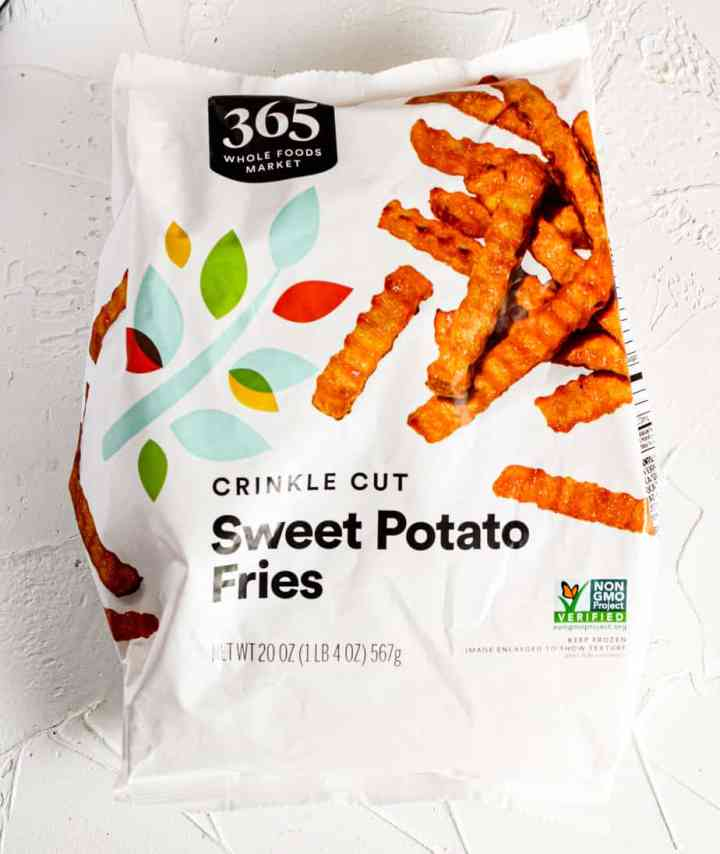 Bag of Frozen Sweet Potato Fries (not open) on a white surface