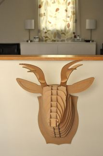 Mr. Deer is on the pony wall that is above the staircase to downstairs.