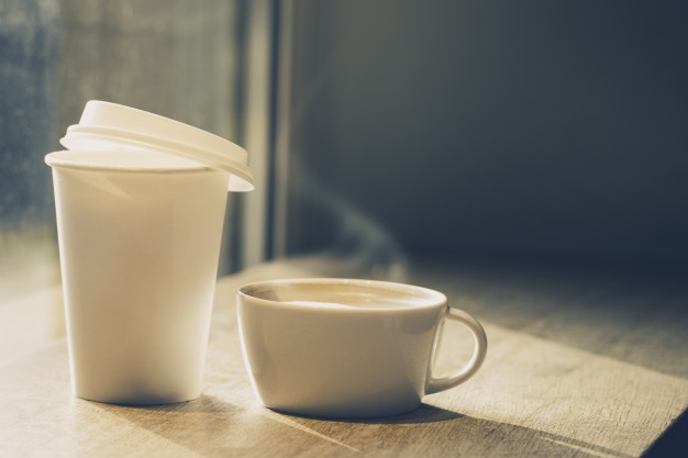 paper coffee cup and ceramic mug