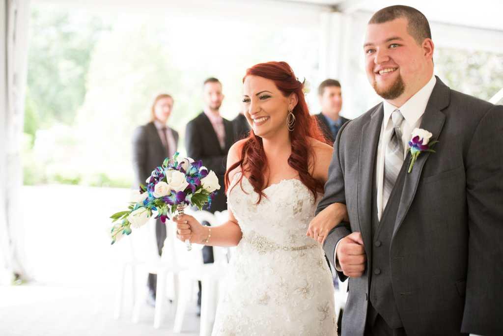 newlyweds walk down aisle