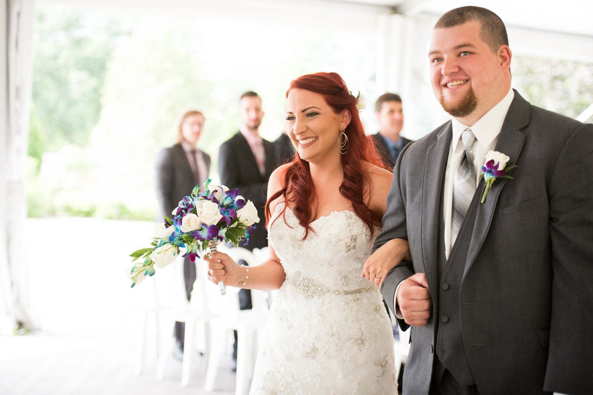 newlyweds walk down aisle