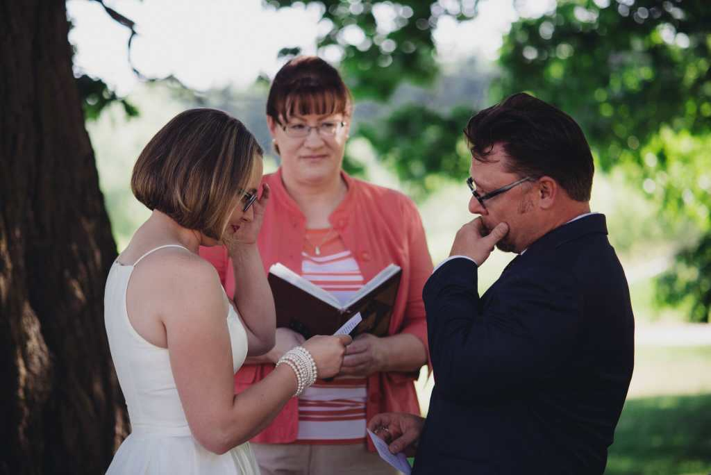 groom cries after saying wedding vows