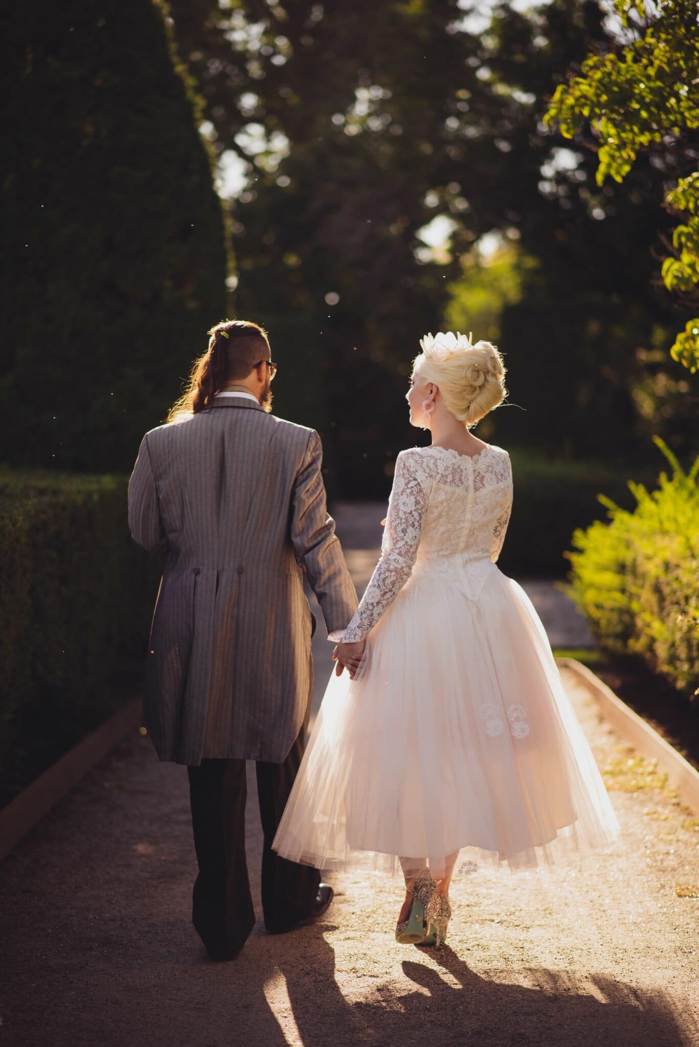 newlyweds walking on the parkwood estate grounds