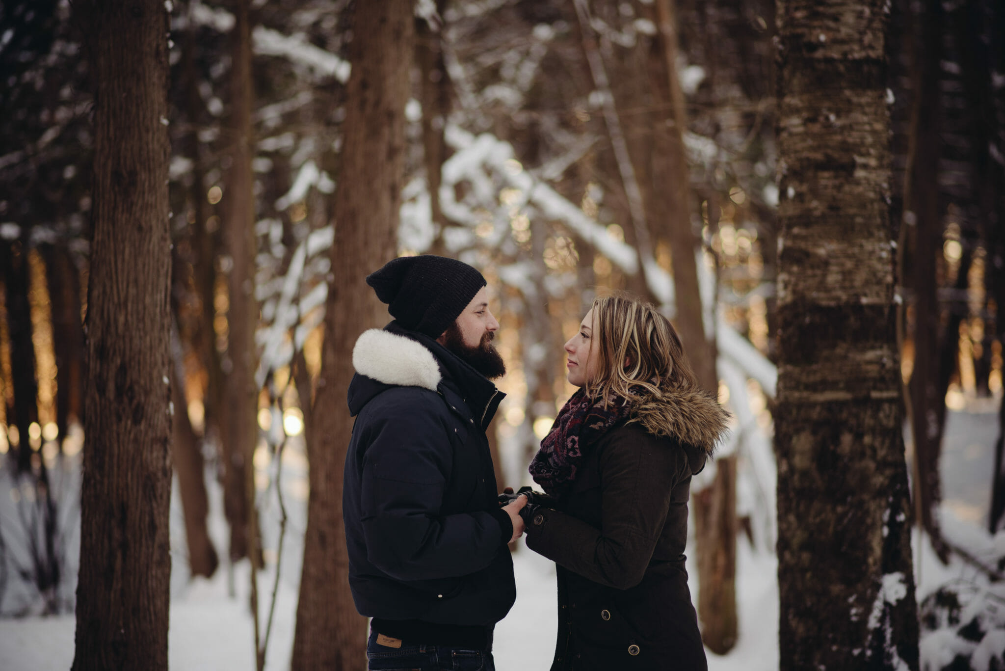 couple holding hands in greenwood conservation area