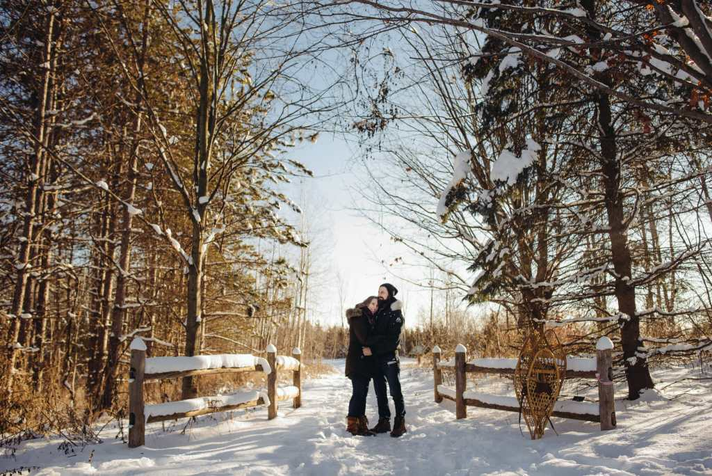 couple standing together on trail in greenwood conservation area