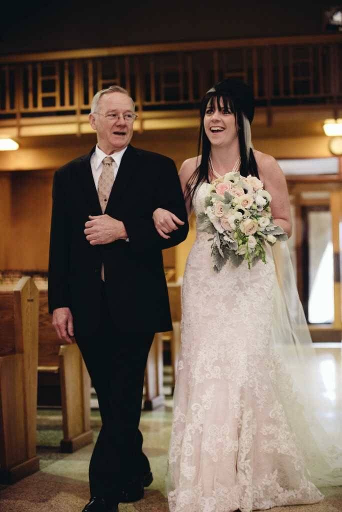 father walks daughter down aisle at st joesphs church wedding bowmanville