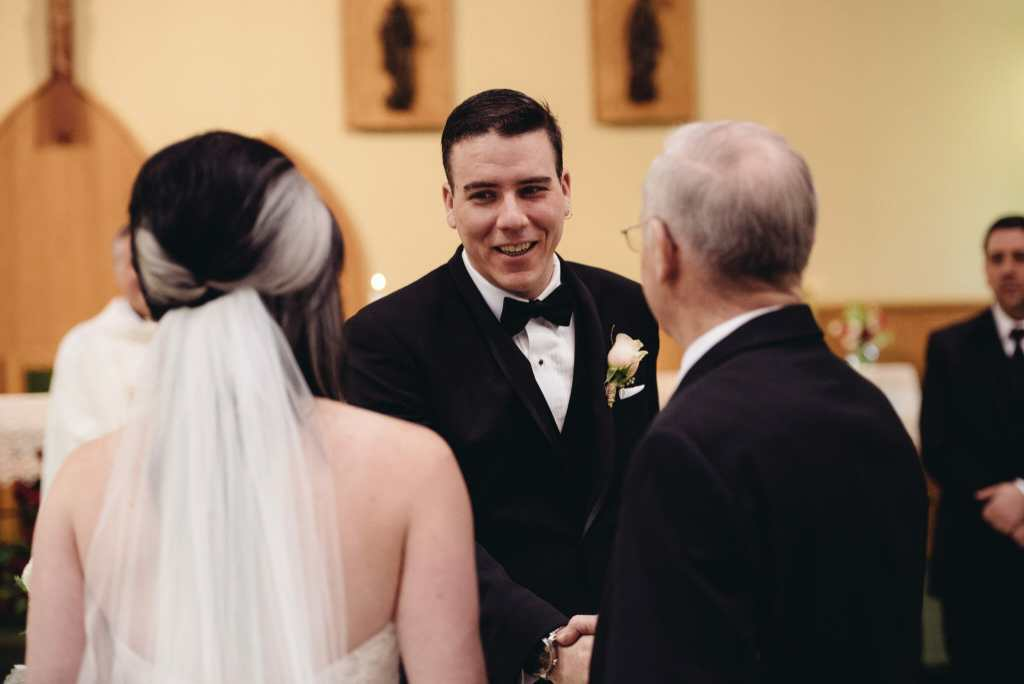 father gives away daughter at st Joseph's wedding bowmanville