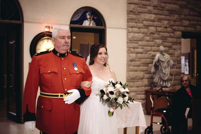 father walking daughter down the aisle at st leo church brooklin wedding