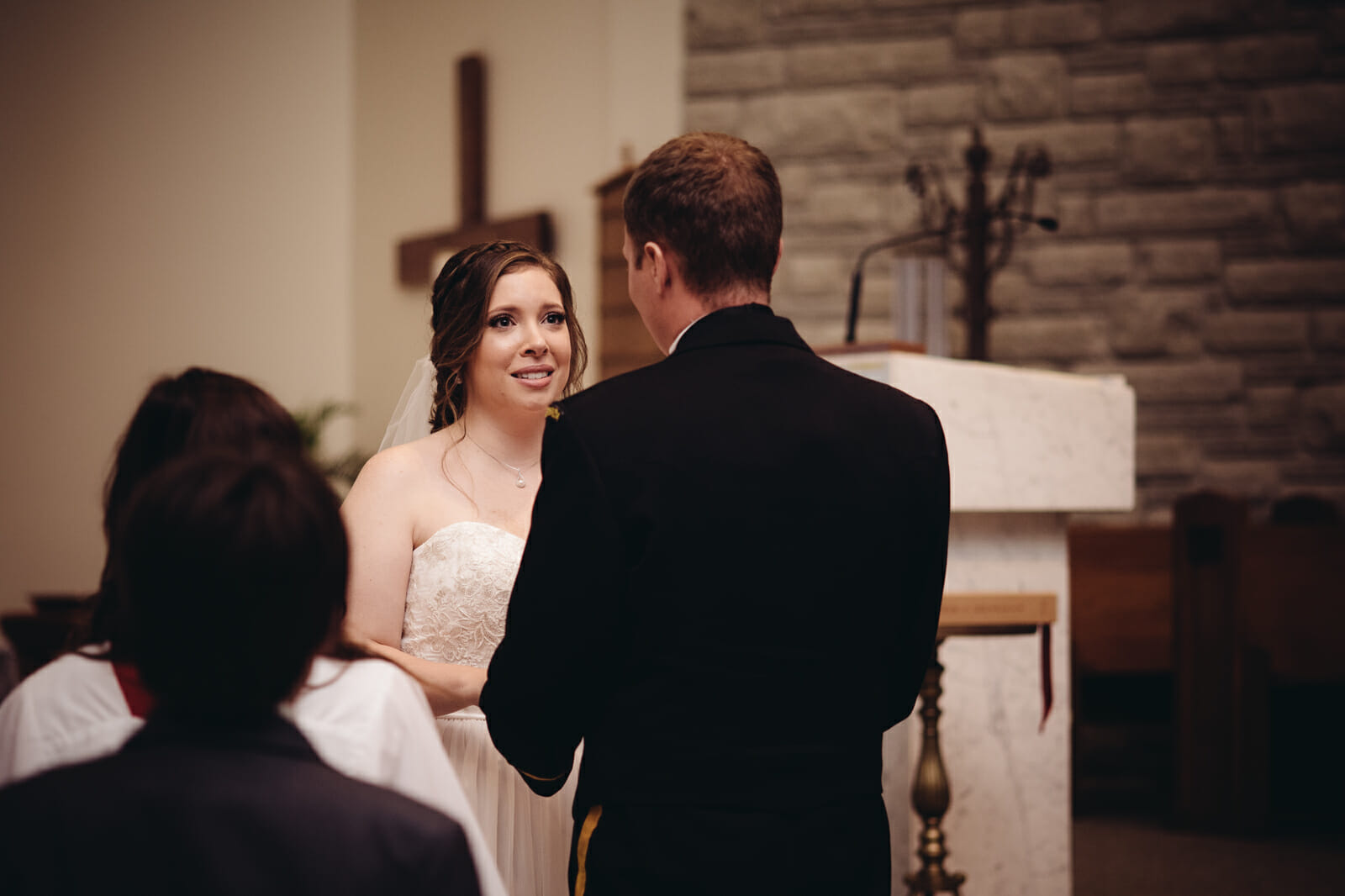 couple says vows during st leo church wedding