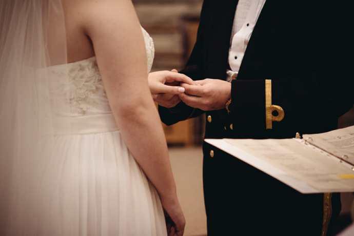 couple exchange wedding rings at st leo church brooklin