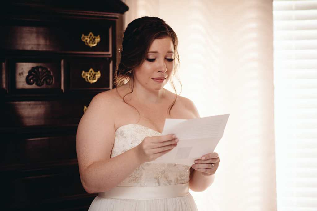 bride reading letter from groom in intimate wedding moment
