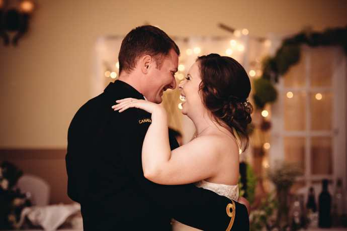 couple laughs during first dance at st leo church