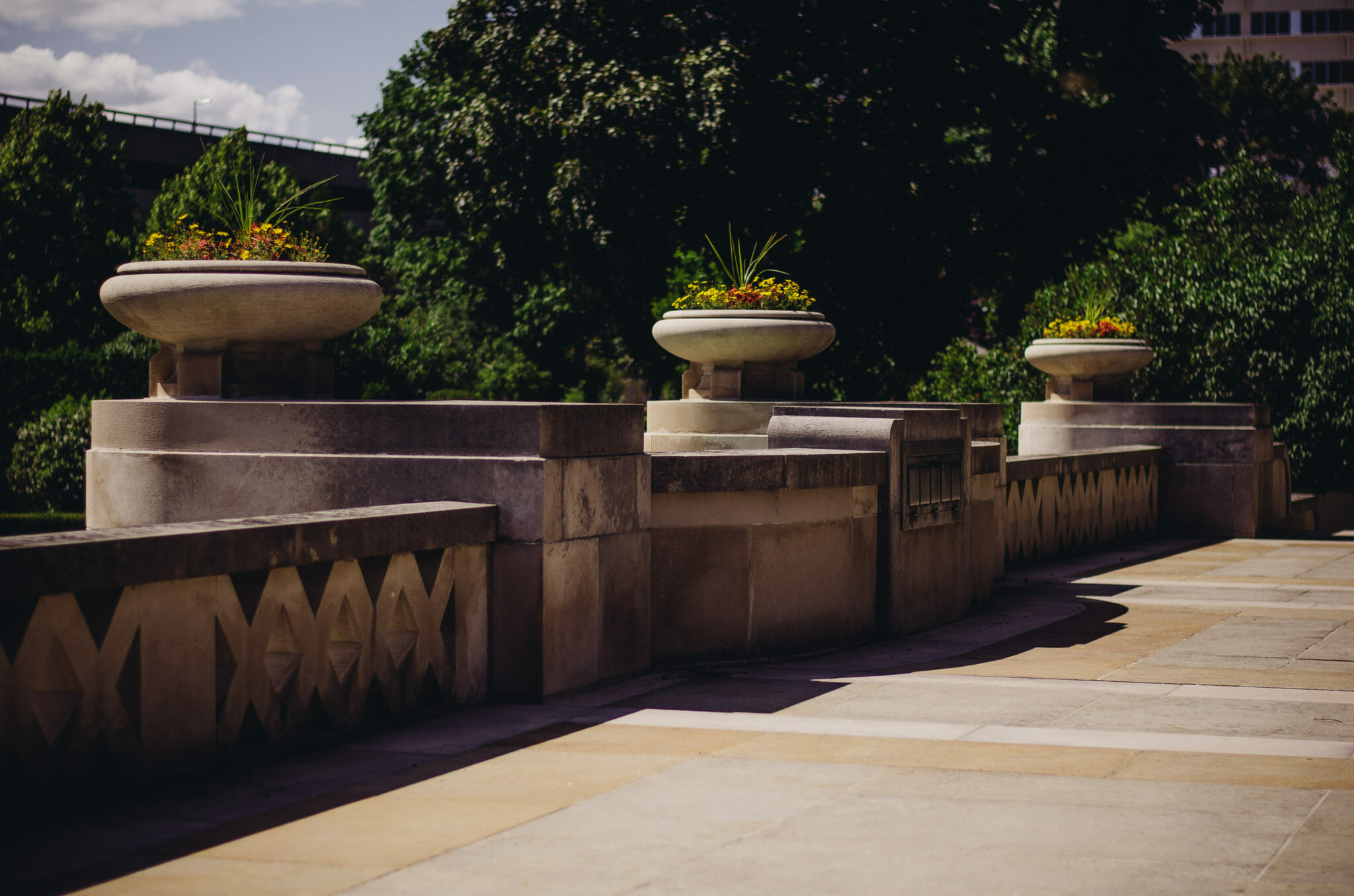 stone railing and flower pots at parkwood