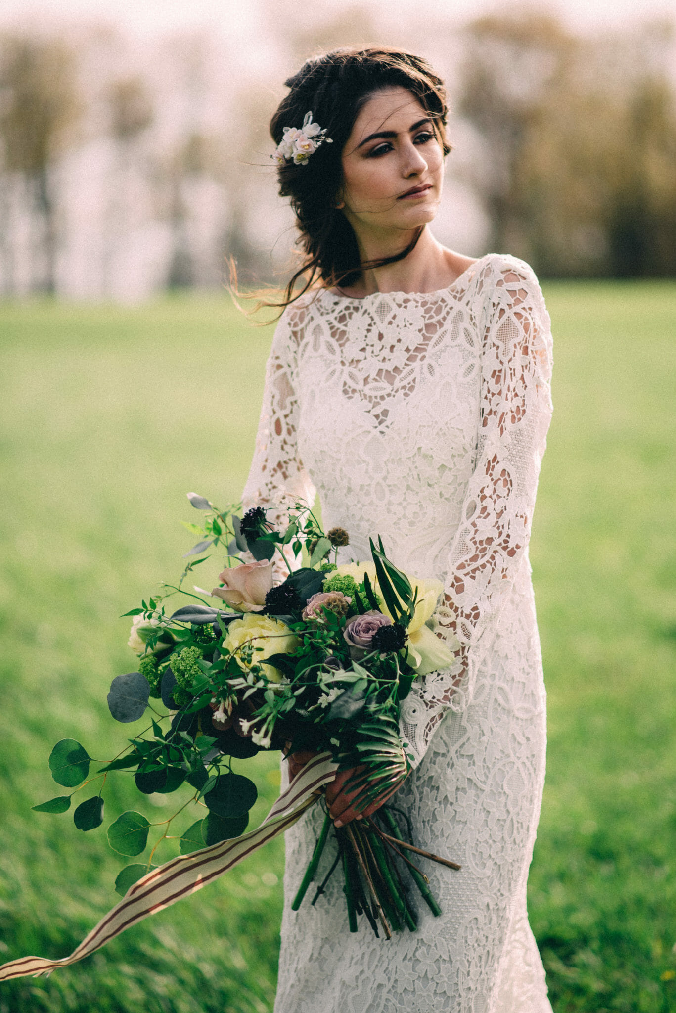 bride wearing lace dress and crown