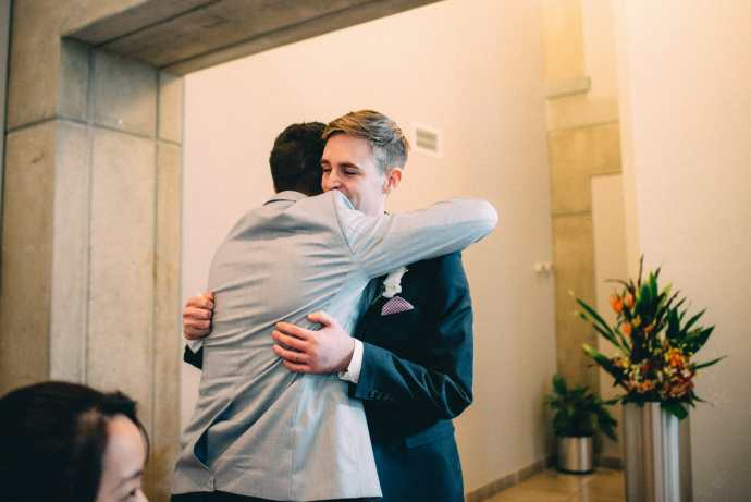 groom receives hug after ceremony