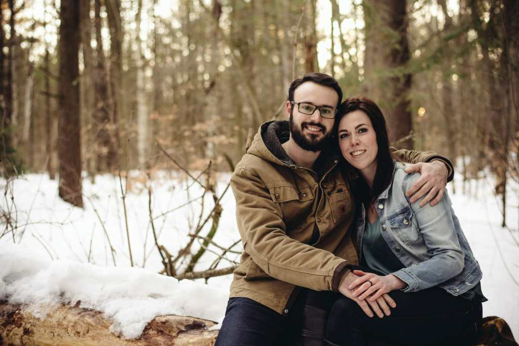 couple embraces during winter photoshoot