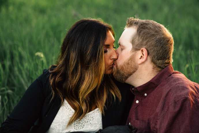 couples kiss during country photo session bowmanville